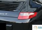 usługi lakiernicze Warszawa, SztukaLakierowania - lakierowanie Porsche Carera, czarny idealny lakier, efekt pracy serwisu lakierniczego, wcześniej auto było zarysowane nad lampą