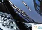 usługi lakiernicze Warszawa, SztukaLakierowania - lakierowanie samochcodu efekty, czyli pięknie lśniące słońce na czarnym lakierze na masce samochodu