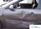 Likwidacja szkody komunikacyjnej czyli wgniecenie drzwi pojazdu, wjechanie w bok auta. Naprawa wykonana przez Sztuka Lakierowania.
