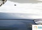 Usługi blacharsko-lakiernicze - idealnie gładka maska auta po naprawie lakierniczej.